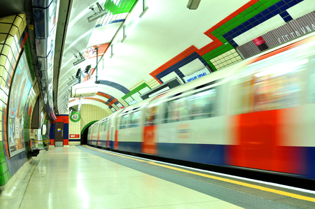 tube station: LONDON, UK - JULY 9, 2014: Modern train leaves the underground tube in London. Editorial