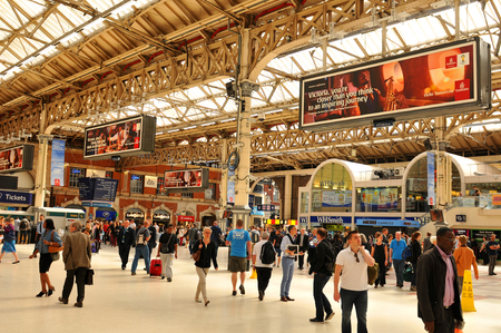 terminals: LONDON, UK - JULY 9, 2014: Rush hour in Victoria Station, London Editorial