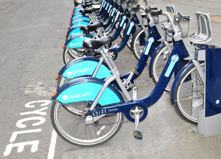 parked bikes: LONDON, UK - JULY 9, 2014: Barclays bikes parked in central London