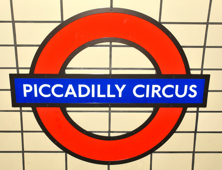 piccadilly: LONDON, UK. JULY 9, 2014: Abstract detail of London Piccadilly Circus underground sign against white tiles.