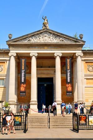 curator: OXFORD, UK - JULY 9, 2014: Tourists visit the Ashmolean Museum of Art and Archaeology in Oxford, Oxfordshire, England.