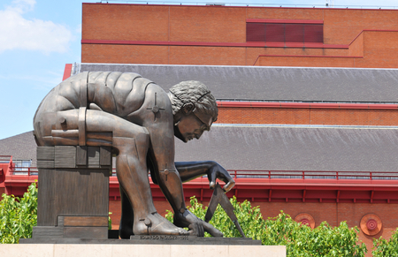 isaac newton: LONDON, UK - JULY 9, 2014: Architectural detail of the Newton statue at the British Library in London