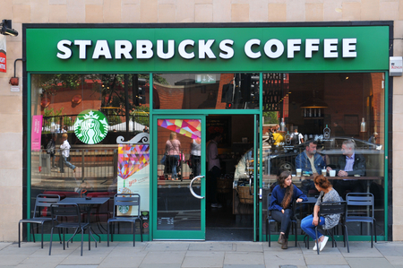 LONDON, UK. JULY 9, 2014: Entrance to Starbucks coffee shop in Central London Editorial