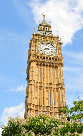 Architectural detail of the Big Ben clock tower against blue sky in London, UK