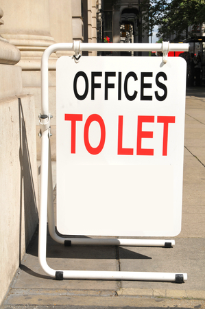 Offices to let sign on the street
