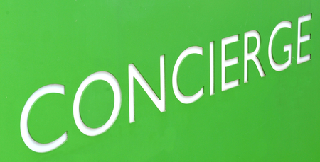 concierge: Concierge sign on green background Stock Photo