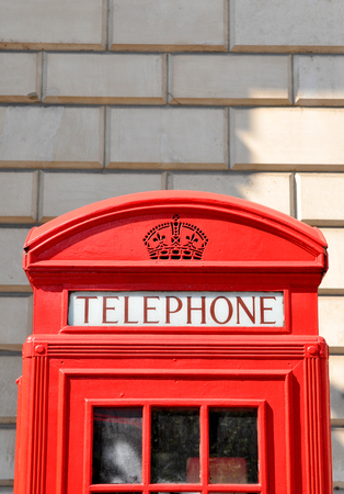 pay wall: Detail of red old telephone booth in Central London Stock Photo