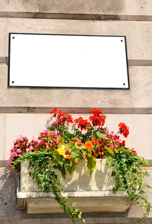 customizable: Customizable old street sign with flower pot Stock Photo