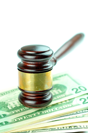 solicitors: Auction concept with gavel on money background