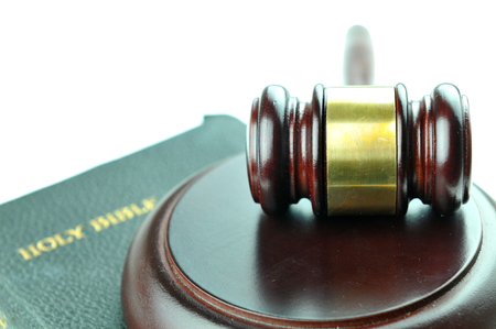 martial law: Justice concept with gavel against the bible Stock Photo