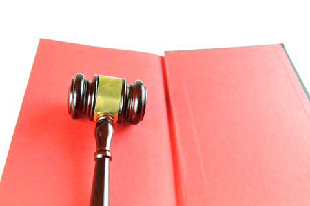 solicitors: Justice concept with gavel against red book
