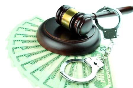 solicitors: Bribe concept with gavel and handcuffs isolated against white background Stock Photo