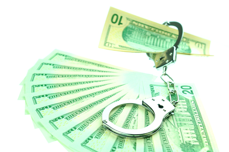 solicitors: Financial crime concept with handcuffs on money background