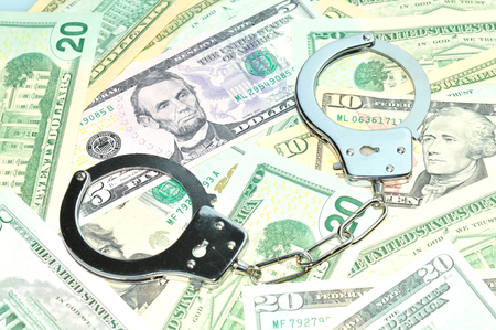 inducement: Bribe concept with gavel and handcuffs isolated against white background Stock Photo