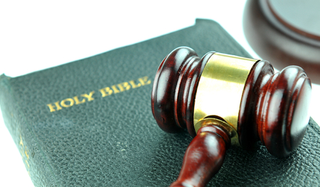 solicitors: Justice concept with gavel against the bible Stock Photo