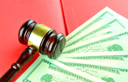 refunds: Gavel and dollars at the auction Stock Photo