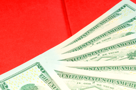 refunds: Abstract money background with US dollars against red background