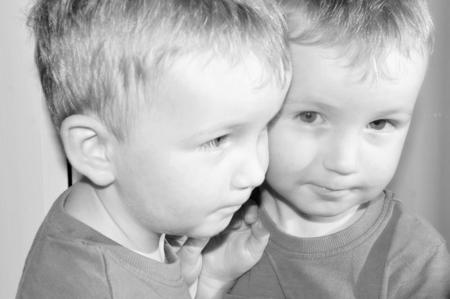 brotherhood: reflection of a boy seems like a Twin brothers Stock Photo