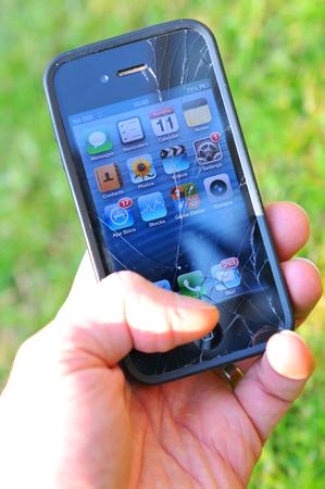 damaged: London, UK - June 12, 2015: Detail of broken iPhone screen.
