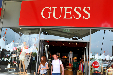 London, UK - June 14, 2015: Detail of entrance to a Guess shop.
