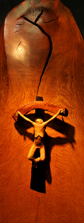 crucified: Lincoln, UK - April 9, 2015: Architectural detail of wooden art by William Fairbank depicting Jesus Christ crucified at Lincoln Editorial
