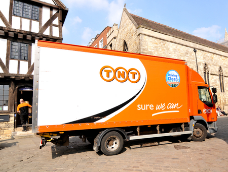 tnt: Lincoln, UK - April 9, 2015: TNT truck delivery in city centre of Lincoln, Lincolnshire, England.