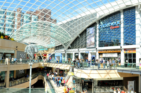 LEEDS, UK - APRIL 17, 2015: People shop in Trinity central mall in Leeds, England, major commercial area of the city.