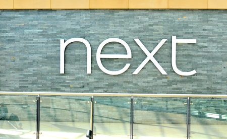 retailer: LEEDS, UK - APRIL 17, 2015: Next logo inside the Trinity shopping centre in Leeds, England.