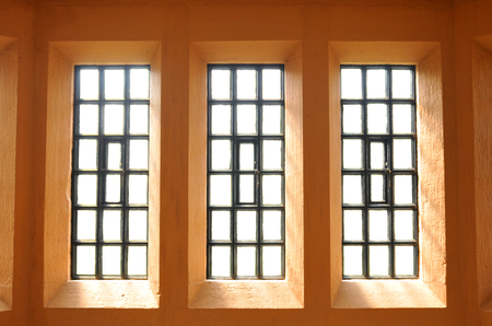 symmetrical: Abstract view of symmetrical windows on colorful wall