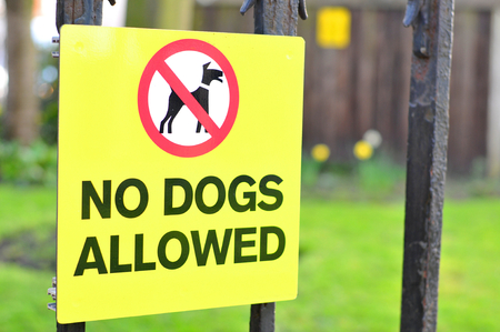 warns: Close up of No dogs allowed sign