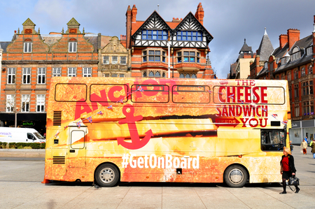 decker: NOTTINGHAM, UK - APRIL 1, 2015: Colorful bus advertises sandwiches brand in the Old Market Square of Nottingham, Nottinghamshire Editorial