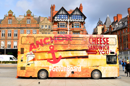 marketers: NOTTINGHAM, UK - APRIL 1, 2015: Colorful bus advertises sandwiches brand in the Old Market Square of Nottingham, Nottinghamshire Editorial