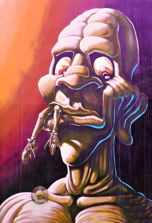 Graffiti: NOTTINGHAM, UK - APRIL 1, 2015: Detail of street art abstract graffiti depicting a monster in Nottingham, East Midlands, England Editorial