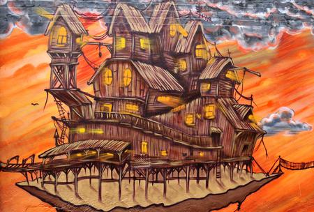 NOTTINGHAM, UK - APRIL 1, 2015:  Detail of street art abstract graffiti depicting fantasy world in Nottingham, East Midlands, England.