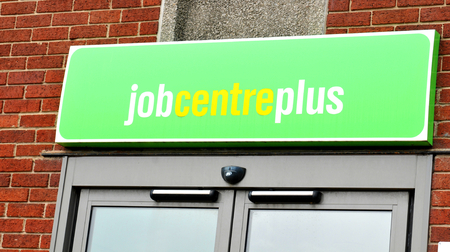 recruiters: NOTTINGHAM, UK - APRIL 1, 2015: Detail of Job Centre Plus sign in Nottingham, East Midlands, England.
