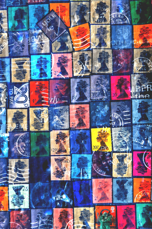 england: NOTTINGHAM, UK - APRIL 1, 2015: Old stamps depicting Queen Elizabeth decorate wall of vintage building in Nottingham, England