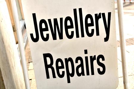 repairs: Close up of jewellery repairs sign Stock Photo