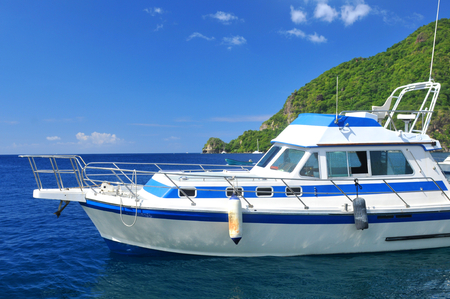 ocean and sea: Yacht anchored in exotic paradise