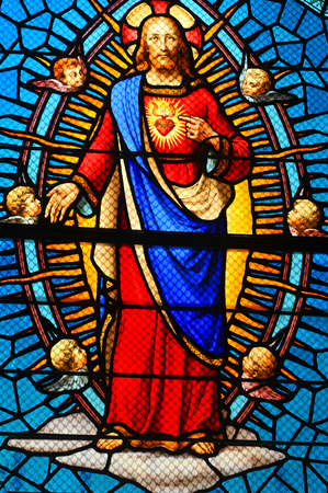 piety: Stained glass window depicting Sacred Heart of Jesus in medieval church