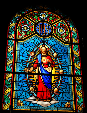 sacred heart: Stained glass window depicting Sacred Heart of Jesus in medieval church