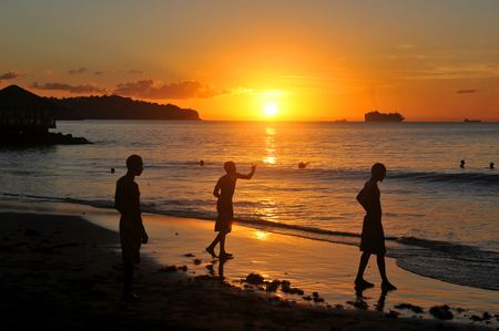 Tourists on the beach at sunset photo