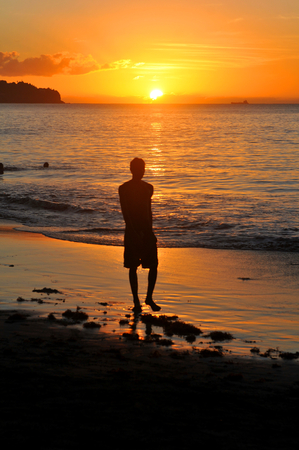 Silhouette of man at sunset photo