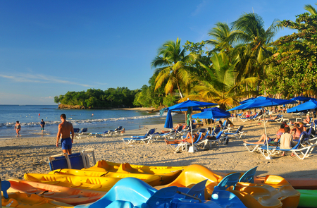 st lucia: SAINT LUCIA, CARIBBEAN - DECEMBER 10, 2014:  Tourists relax by the sea in exotic resort in Saint Lucia, Caribbean
