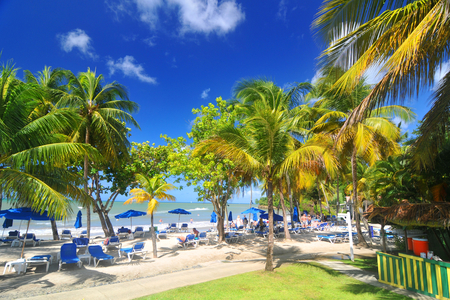 saint lucia: SAINT LUCIA, CARIBBEAN - DECEMBER 10, 2014: Tourists relax by the sea in exotic resort in Saint Lucia, Caribbean Editorial