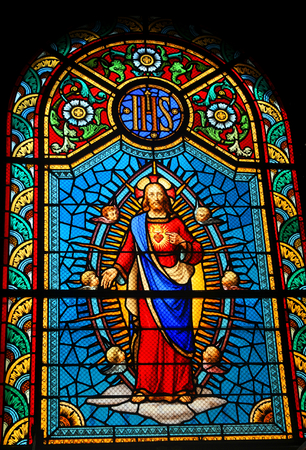 liturgical: FORT-DE-FRANCE, MARTINIQUE - DECEMBER 16, 2014: Stained glass window depicting Sacred Heart of Jesus in medieval church
