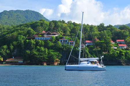 excursions: SAINT LUCIA, CARIBBEAN - DECEMBER 10, 2014: Tourists sail in luxurious catamaran across the Caribbean sea Editorial