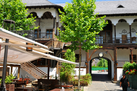 hotel building: BUCHAREST, ROMANIA - JUNE 24, 2015. Inner yard at Hanul lui Manuc Manucs Inn the oldest operating hotel and restaurant building in downtown of Bucharest, Romania