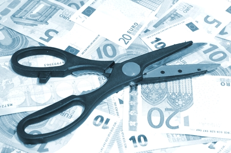 savings problems: Financial concept with scissors and euro banknotes