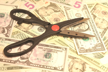 budgets: American dollars budget cut concept Stock Photo