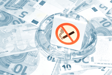 budget restrictions: No smoking concept with euros Stock Photo